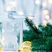 Beautiful white Christmas lantern on bokeh background of garlands