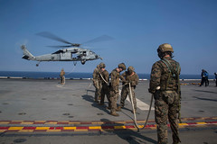 """Marines disconnect from a line affixed to a MH-60S Seahawk helicopter during Special Patrol Insertion and Extraction (SPIE) training (#PACOM) Tags: 31stmarineexpeditionaryunit specialpatrolinsertionextraction usswasplhd1 marines reconnaissance southchinasea masscommunicationspecialist2ndclassstormhenry """"usindopacificcommand usindopacom"""""""