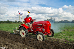 Porsche Passion | 1959 PORSCHE DIESEL Vintage Tractor (martin_king.photo) Tags: vintageploughing vintagetractor farmer visitors customers show martinkingphoto sky clouds cloudyday all everything servis tschechische republik powerfull martin king photo machines strong greatday great czechrepublic vintage old red youngtimer agriculture power dynastyphotography lukaskralphotocz day fans work place agricultural welovefarming agriculturalmachinery farm workday working modernagriculture landwirtschaft moisson machine machinery porsche porschetractor porschediesel 1959porschediesel man ploughing worker porschefan