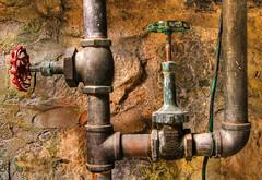 Old Pipes (arbyreed) Tags: arbyreed metal pipes copper brass valves plumbing stone rock oldplumbing vintageplumbing spanishforkutah utahcountyutah