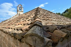 Roof with a bell tower (Yirka51) Tags: belltower bell wood wall village tower stonewall stone sky rooftile roof religion old christianity historical historic forest croatia cloud catholic building brick architecture