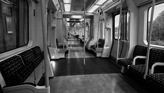 Travelling alone. (Steve.T.) Tags: underground londonunderground londontransport blackandwhite bnw tubetrain metro empty emptytrain transport publictransport phonepic mobilepic sonyxperia urban london emptyseats subway vanishingpoint perspective