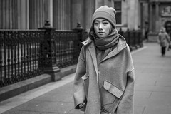 The Oversized Coat (Leanne Boulton) Tags: portrait urban street candid portraiture streetphotography candidstreetphotography candidportrait streetportrait eyecontact candideyecontact streetlife woman female girl pretty face eyes expression mood feeling hat beanie weather cold oversized coat style fashion tone texture detail depthoffield bokeh naturallight outdoor light shade city scene human life living humanity society culture lifestyle people canon canon5dmkiii 70mm ef2470mmf28liiusm black white blackwhite bw mono blackandwhite monochrome glasgow scotland uk
