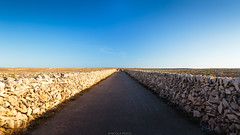 Infinite road (Nicola Pezzoli) Tags: menorca baleares baleari island nature spain sea minorca isola punta nati road sunset blue sky orange