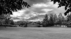 Saguenay-04 (Agirard) Tags: urban park chicoutimi saguenay quebec canada bw nb blackwhite noirblanc historic vintage trees grass clouds sky sony a7ii zeiss loxia 235mm 35mm