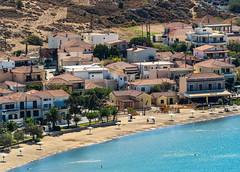 Town Beach ( and Cocktail Cafe serving Vegina Dark) (View from Myrina Castle)  Limnos - Greece (Olympus OM-D EM1-II & M.Zuiko 40-150mm f2.8 with MC14 Teleconverter) (1 of 1) (markdbaynham) Tags: greece greek hellas hellenic grecia greka gr greekisland greekholiday greektown northaegean northaegeanisland aegeanisland travel olympus omd olympusomd olympusgreece olympusmft olympusem1 m43 m43rd micro43 em1 em1mk2 em1mark2 em1ii csc evil mirrorless microfourthird microfourthirds greektravel hellenicisland limnos lemnos myrina mypina myrinatown beach townbeach mc14 40150mm f28 mzd zd mz zuikolic