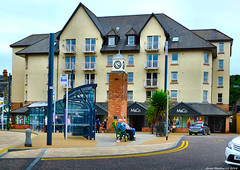 Scotland West Highlands Argyll Oban the flats next to the train station 7 July 2018 by Anne MacKay (Anne MacKay images of interest & wonder) Tags: scotland west highlands argyll oban flats apartments town square clock people road cars 7 july 2018 picture by anne mackay