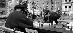 Chess Time in NYC (captures.in.time) Tags: chess streetphotography newyork newyorknewyork bigapple usa america washington washingtonsquare travel travelphotography lonelyplanet nationalgeographic ngm lp black african king queen sun street park candid friends game city raw new york