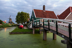 Cheese farm . (rudi.verschoren) Tags: cheese farm bridge footpath river windmill zaanse shans holland old canal tree heritage landscape light lines mood sunrise europe exposure reflection autumn outdoor overlooking outside colors contrast