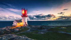 Lindesnes lighthouse (bjorns_photography) Tags: landscape lighthouse sunset clouds color nature view rock water ocean