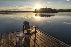 Time for coffee (mystero233) Tags: morning sunrise sun dawn muskoka ontario canada lake muskokalakes water reflection calm north america relax dock chair island forest tree blue sky