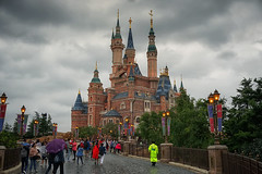 Blame it on the Rain (Gary Burke.) Tags: shanghaidisneyland castle path sky clouds weather rain raining enchantedstorybookcastle disney themepark citylife cityliving city travel wanderlust tourism traveling touristattraction details colorful vacation klingon65 building garyburke travelphotography citystyle people tourists disneypark architecture shanghai view outdoor urban lights buildings trip asia chinese asian sony a6300 mirrorless sonya6300 china prc peoplesrepublicofchina seetheworld disneyside park fantasyland resort pudong disneyresort gloom moody gloomy shanghaidisneyresort
