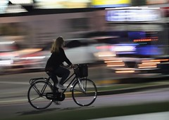 Movement (carlos_ar2000) Tags: ciclista cyclist movimiento movement noche night chica girl mujer woman calle street luz light linea line color colour buenosaires argentina