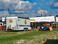 Trailer And Portable Kitchen. (dccradio) Tags: lumberton nc northcarolina robesoncounty outdoor outdoors outside sky bluesky cloud clouds cloudformation september sunday afternoon fall autumn hydepark hydeparkbaptistchurch hurricaneflorence reliefstation disasterrelief naturaldisaster hurricane florence trailer ncbaptists baptistmen baptistsonmission grass lawn yard ground portablekitchen tent field dirt sand pylon cone canon powershot elph 520hs