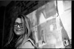 StephViniCultureTriX1600_038 (Johnny Martyr) Tags: existinglight availablelight pushprocess kodaktrix kodaktrix1600 blackandwhiteportraitofabeautifulgirl viniculture frederickmaryland blondehighlights nosering girlinglasses woman portrait bw blackandwhite m6 leica leitz summicron 90mm 35mm film rangefinder lines leadinglines composition smile cute contrast