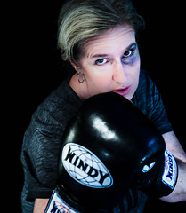 U messed with the wrong girl (smeerjewegproducties) Tags: boxing female shiner black eye blue injury eyes gloves round sparring sport woman boxer look fierce