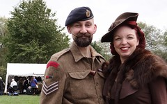 Couple In the 40s. Sept 2018 (Simon W. Photography) Tags: 1940 1940s livinghistory reenactment army britisharmy woman women girl girls lady ladies female females candid fashion style legs dress highheels people person groupshot crowd man men male gentlemen gentleman manandwoman menandwomen couple face faces hat mustache hats cap caps history historic war simonhx100v sonyhx100v hx100v event royal royalengineers ruffordabbey nottingham nottinghamshire homefront smile smiles smiling