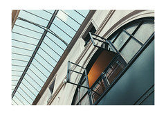 The Bird is shopping (Thomas Listl) Tags: thomaslistl color paris france window ceiling diagonal lines geometry architecture passage orange blue sky indoor inside glass stripes 35mm sunday shopping gallery passagecolbert