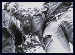 Jacqueline & Sammy, early 1980s (Dimi Sahn) Tags: man crotch woman portrait sky tree torso pubis backpack smile