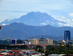 Mount Kinabalu's Out! (thienzieyung) Tags: view scenery vista clear rare nature terrain slopes peaks jagged tropics blue range contours clouds buildings houses akinabalu mount kotakinabalu sabah malaysia borneo thienzieyung morning