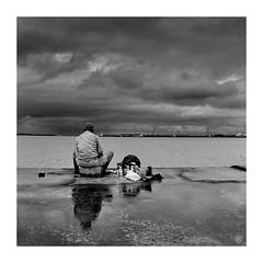 Fisherman (Hamilton Ross) Tags: cityscape okinawa water landscape pacific bw square fisherman