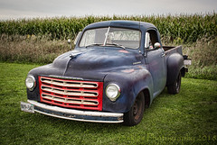 Studebaker by the Corn (HTT) (13skies (Cast off, brace on. Healed but still sore) Tags: studebaker truck htt grill redgrill cool old classic happytruckthursday pickup carshow headlights saturday truckthursday flatblack antique drive hauling moving wheels canont3i
