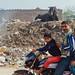Family on Motorbkie by Village Landfill, Mathura India