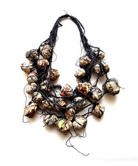 for wearing the news (Ines Seidel) Tags: necklace newspaper paper plant sage wearable burnt crumbled crochet yarn zeitungspapier nachrichten news tragbar jewelry artjewelry