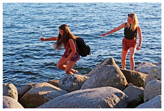 A question of Balance (HereInVancouver) Tags: youngwomen rocks balance walking water ocean pacific englishbay vancouverswestend candid streetphotography canong3x vancouver bc canada thingstodobythewater