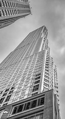 Almost into the Clouds (allentimothy1947) Tags: financialdistricts frankgehrybuilding newyorkstate cloudy newyorkcity rain 8786 buildings architechure art black white financial districts frank gehry building new york state other keywords bw clouds highrise looking up modern city office residential sky skyscraper windows
