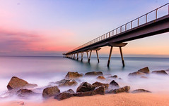 Pont del Petroli (Daniel Muñoz Uribe..) Tags: barcelona longexposure badalona pontdelpetroli sea waves bridge beach water rocks sand clouds sunset atardecer sol playa arena rocas piedras agua largaexposición canon t1i