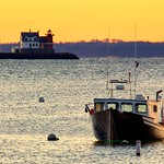 The glow of early morning light in the harbor. thumbnail