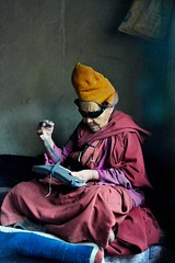 Nun opens her prayer book