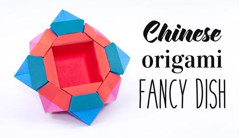 Star Ball by Tomoko Fuse   Modular origami, Origami stars, Origami ...   281x500