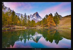 Cervino Alpenglow (Ilan Shacham) Tags: landscape view scenic beauty reflection mountain alps trees pond lake dusk alpenglow cervino matterhorn italy cervinia lagoblu clouds red fineart fineartphotography sunset