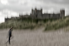 Reminiscent of L S Lowry (CEWWtyke) Tags: lowry bamburgh northumberland england uk great britain beach coast shore shoreline sand dunes castle armstrong walker figure person icm intentional camera movement abstract lee filters 6stop long exposure handheld blur motion motionblur grass sky