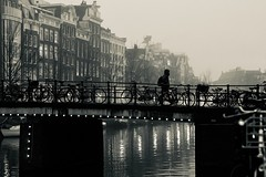 bridge decorated by bicycles (c222ut2) Tags: amsterdam human canal gracht bridge 85mm zeiss bw noir cold mist fog