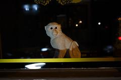 London (jaumescar) Tags: nopeople london england unitedkingdom monkey window eyes night still life animal weird decoration look street ceramics light dark