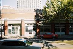 red mustang (jayplorin) Tags: san jose california canon ae1 film mustang buildings city urban street road cars windows kodak gold 200 35mm