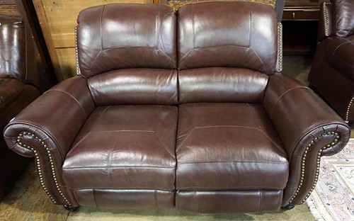 Brown leather reclining loveseat ($336)