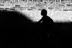 _MG_9679 (JetBlakInk) Tags: magichour moment silhouette transport cyclist bicycle women shadows shadow shadowyfigure streetphotography lowkey brickwall