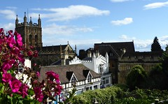 Malvern View. (jenichesney57) Tags: malvern worcestershire priory s2y blue couds buildings flowers roofs panasonic lumix white abbeyarchway view