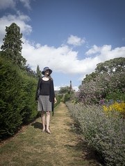 Mariëlle, Norfolk 2018: Sheltering from the wind (mdiepraam (30 mln views!)) Tags: norfolk 2018 oxburghhall nationaltrust marielle portrait pretty gorgeous attractive mature fiftysomething brunette woman lady milf elegant classy hat skirt garden path flowers