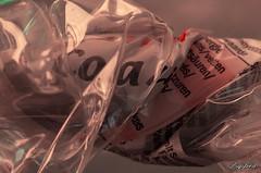 Crinkled  bottle. (Digifred.nl) Tags: macromondays crinkledwrinkledfoldedorcreased digifred 2018 nederland netherlands pentaxk5 hmm macro macrophotography closeup crinkled wrinkled folded creased bottle colaflesje fles petfles