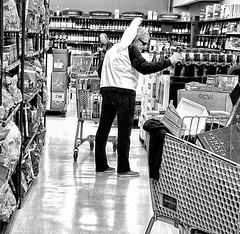 Shopper (creepingvinesimages) Tags: happy monochrome monday hbm blackandwhite bw shopping grocerystore wine oregon indoors retail samsung galaxy s9 pse14 topaz