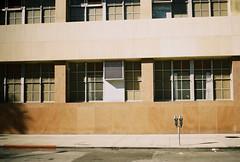 window meters (jayplorin) Tags: san jose california canon ae1 film windows parking meter city urban buildings street kodak gold 200 35mm