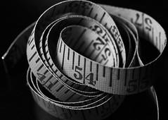 Coiled (j.towbin ©) Tags: allrightsreserved© macro numbers tape tapemeasure coiled measuringdevice bw monochrome img2764 macromondays measurement ef100mmf28lisusmmacro