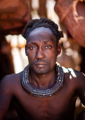 Himba tribe man with the traditional necklace, Cunene Province, Oncocua, Angola (Eric Lafforgue) Tags: adult africa africantribe angola angolan black colourimage cultures cuneneprovince day developingcountries hairhairstyle herero himba humanbeing indigenousculture lifestyles lookingatcamera married necklace oncocua onemanonly oneperson outdoors photography portrait ruralscene traditionalclothing tribal tribe vertical ang0k6g7383