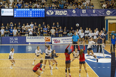 Swinging for a Kill on the Volleyball Court (aaronrhawkins) Tags: volleyball girls womens net kill swing hit ball spike byu brighamyounguniversity stmarys smithfieldhouse college university ncaa crowd cheer player jump block game match set ronijonesperry hitter outside team ranked numberone provo utah aaronhawkins