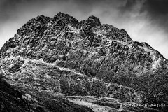 Tryfan mountain East Face (Adrian Evans Photography) Tags: welshlandscape snowdonia landscape winter tryfaneast landmark mono eastface tryfanmountain heatherterrace snowcapped wales nor'nor'buttress november snowdonianationalpark snow bastowbuttress uk adrianevans northwales tryfan sky outdoor clouds blackandwhite southbuttress milestonebuttress d850 nikon